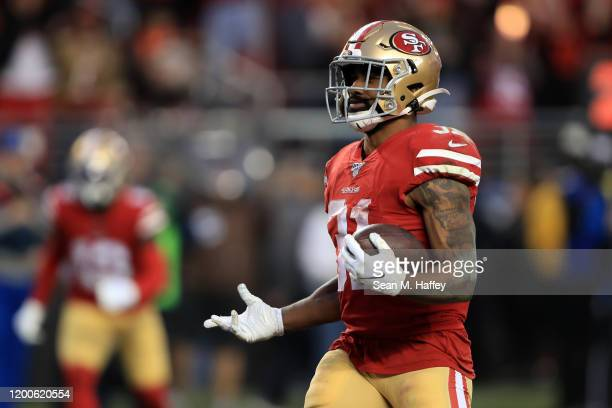 Raheem Mostert of the San Francisco 49ers celebrates a touchdown in the second quarter against the Green Bay Packers during the NFC Championship game...