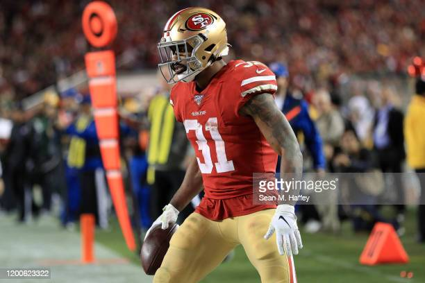 Raheem Mostert of the San Francisco 49ers celebrates a touchdown in the third quarter against the Green Bay Packers during the NFC Championship game...