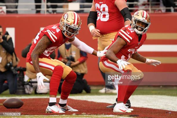 Raheem Mostert of the San Francisco 49ers celebrates a touchdown with Kendrick Bourne during the first quarter against the Green Bay Packers during...