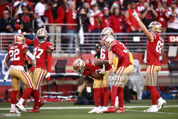Raheem Mostert of the San Francisco 49ers celebrates after recovering a fumbled punt by the Minnesota Vikings during the NFC Divisional Round Playoff...