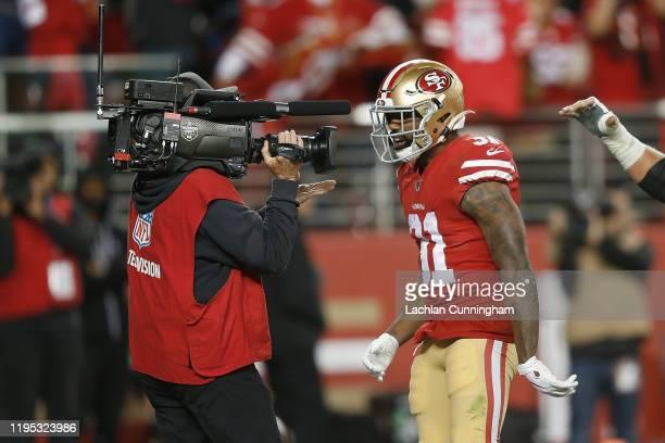 Raheem Mostert of the San Francisco 49ers celebrates after running the ball into the end zone for a touchdown in the second quarter against the Los...