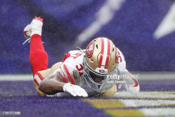 Raheem Mostert of the San Francisco 49ers celebrates scoring a touchdown during the second quarter against the Baltimore Ravens at M&T Bank Stadium...