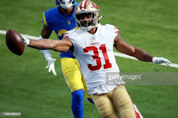 Raheem Mostert of the San Francisco 49ers celebrates scoring a touchdown during the first quarter against the Los Angeles Rams at SoFi Stadium on...