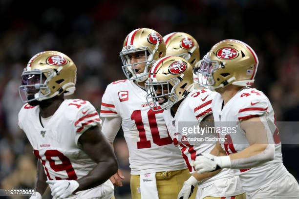 Raheem Mostert of the San Francisco 49ers celebrates with Jimmy Garoppolo after scoring a 10 yard touchdown against the New Orleans Saints during the...
