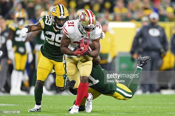Raheem Mostert of the San Francisco 49ers is brought down by Ha Ha ClintonDix of the Green Bay Packers during the second quarter at Lambeau Field on...