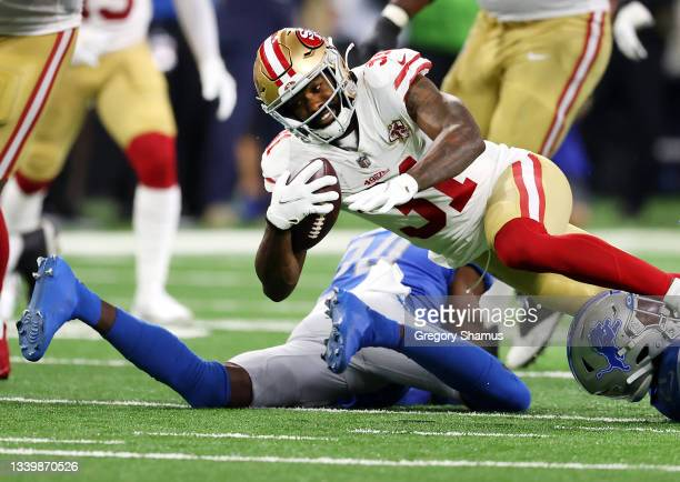 Raheem Mostert of the San Francisco 49ers is tackled during the first half against the Detroit Lions at Ford Field on September 12, 2021 in Detroit,...