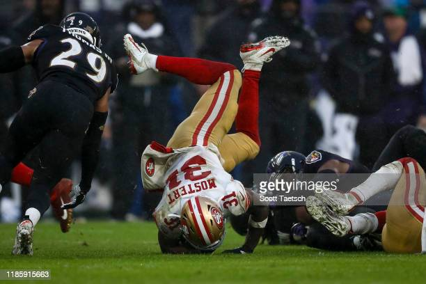 Raheem Mostert of the San Francisco 49ers is upended in the second half of the game against the Baltimore Ravens at M&T Bank Stadium on December 1,...