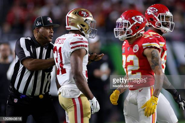 Raheem Mostert of the San Francisco 49ers reacts against Tyrann Mathieu of the Kansas City Chiefs during the second quarter in Super Bowl LIV at Hard...