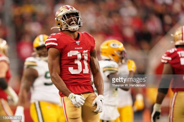 Raheem Mostert of the San Francisco 49ers reacts to a run in the first half against the Green Bay Packers during the NFC Championship game at Levi's...