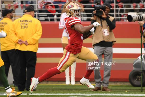 Raheem Mostert of the San Francisco 49ers runs for a touchdown against the Green Bay Packers during the NFC Championship game at Levi's Stadium on...