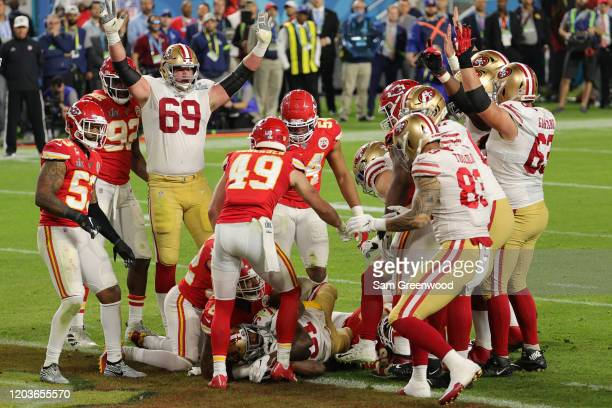 Raheem Mostert of the San Francisco 49ers runs for a touchdown against the Kansas City Chiefs during the third quarter in Super Bowl LIV at Hard Rock...