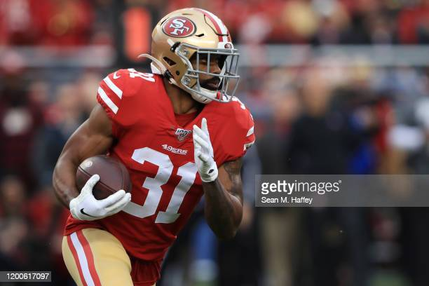 Raheem Mostert of the San Francisco 49ers runs the ball in the first half against the Green Bay Packers during the NFC Championship game at Levi's...