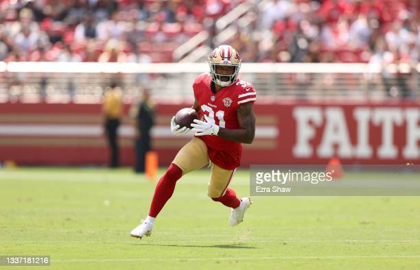 Raheem Mostert of the San Francisco 49ers runs with the ball during their preseason game against the Las Vegas Raiders at Levi's Stadium on August...
