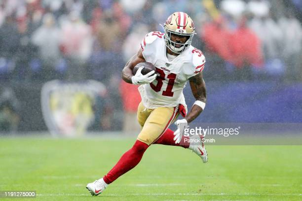 Raheem Mostert of the San Francisco 49ers rushes for a 40-yard touchdown during the second quarter against the Baltimore Ravens at M&T Bank Stadium...