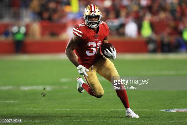 Raheem Mostert of the San Francisco 49ers rushes with the ball against the Green Bay Packers during the NFC Championship game at Levi's Stadium on...