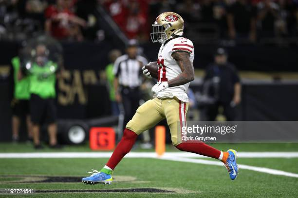 Raheem Mostert of the San Francisco 49ers scores a 10 yard touchdown against the New Orleans Saints during the second quarter in the game at Mercedes...