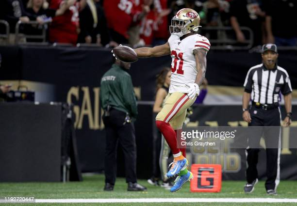Raheem Mostert of the San Francisco 49ers scores a 35 yard touchdown thrown by Emmanuel Sanders against the New Orleans Saints during the second...