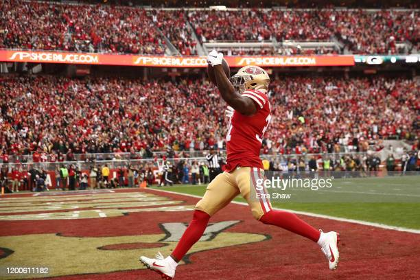 Raheem Mostert of the San Francisco 49ers scores a touchdown during the first quarter against the Green Bay Packers during the NFC Championship game...