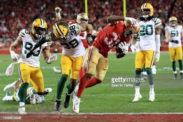 Raheem Mostert of the San Francisco 49ers scores a touchdown in the third quarter against the Green Bay Packers during the NFC Championship game at...
