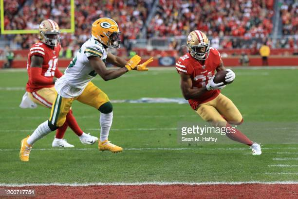 Raheem Mostert runs for a touchdown in the second quarter against the Green Bay Packers during the NFC Championship game at Levi's Stadium on January...