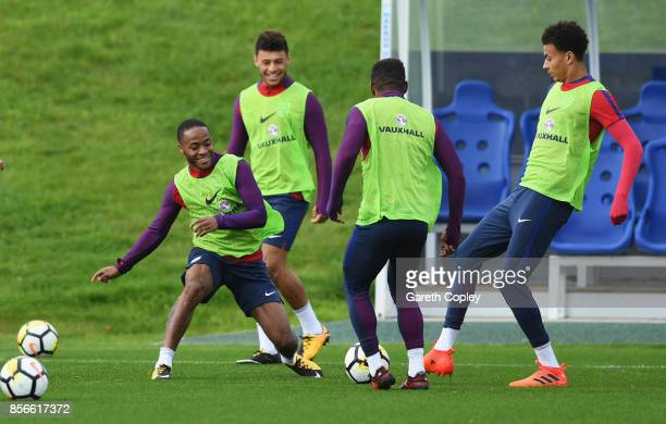 Raheem Sterling Alex OxladeChamberlain Jermain Defoe and Dele Alli of England in action during an England training session at St Georges Park on...