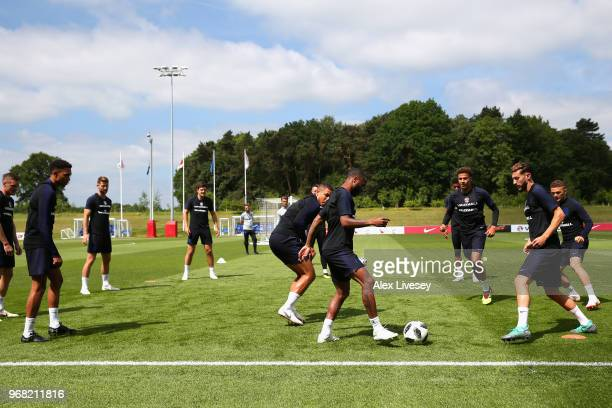 Raheem Sterling and Adam Lallana of England in action during the England training session at St Georges Park on June 6 2018 in BurtonuponTrent England
