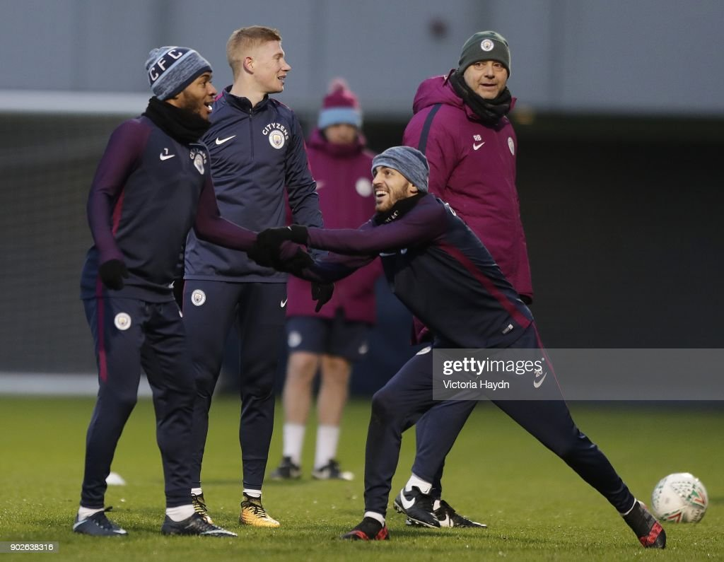 Raheem Sterling and Bernardo Silva joke during training at Manchester City Football Academy on January 8, 2018 in Manchester, England.