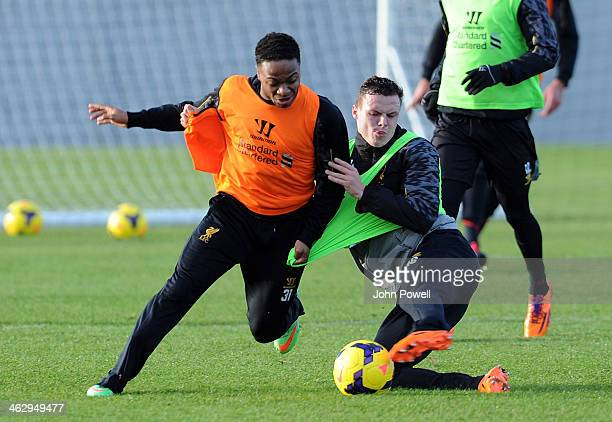 Raheem Sterling and Brad Smith of Liverpool in action during a training session at Melwood Training Ground on January 16 2014 in Liverpool England