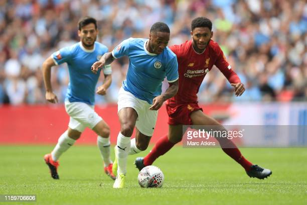 Raheem Sterling and David Silva of Manchester City in action with Joe Gomez of Liverpool during the FA Community Shield match between Liverpool and...