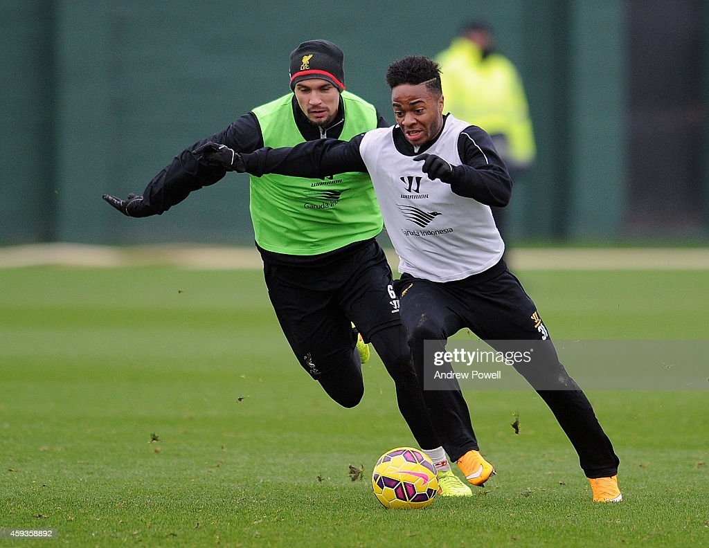 Raheem Sterling and Dejan Lovren of Liverpool during a training session at Melwood Training Ground on November 21, 2014 in Liverpool, England.