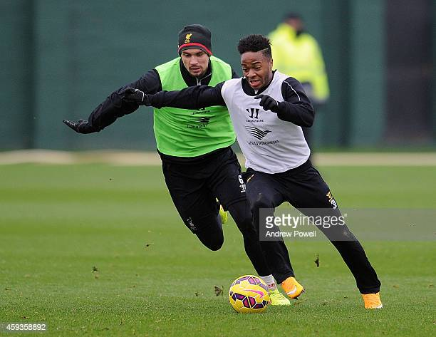 Raheem Sterling and Dejan Lovren of Liverpool during a training session at Melwood Training Ground on November 21 2014 in Liverpool England
