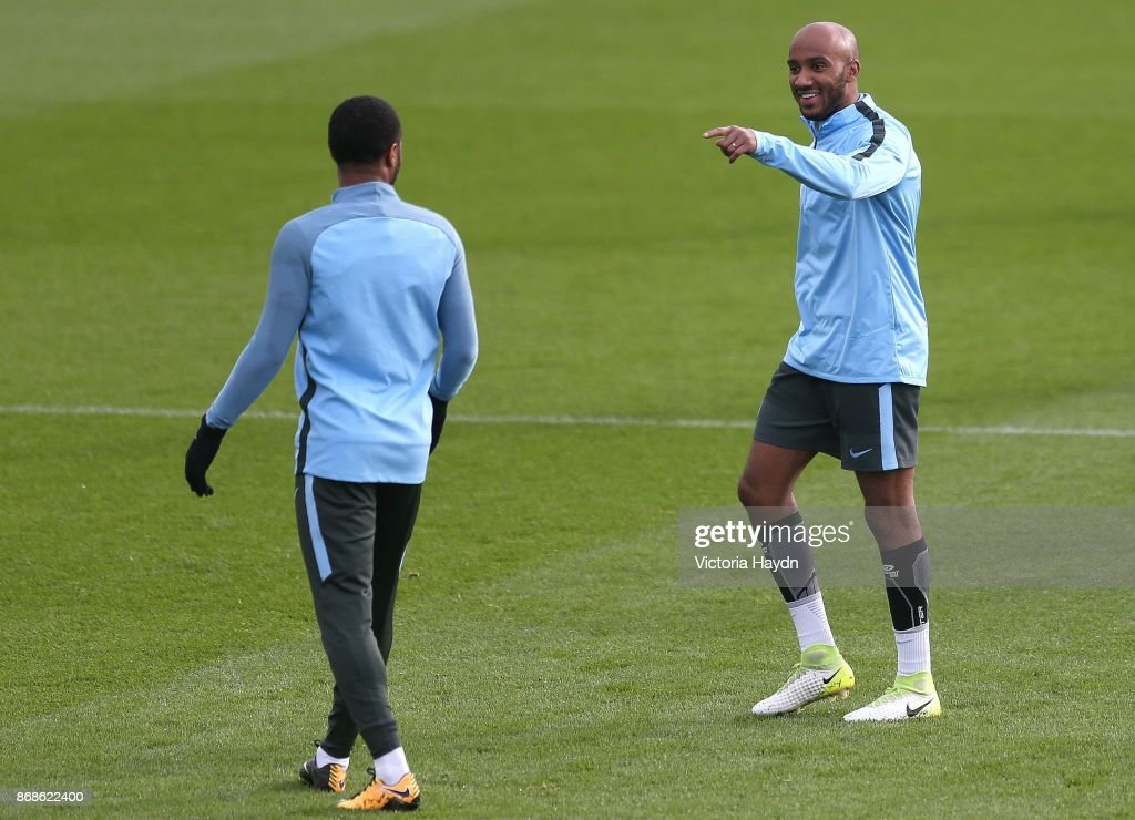 Raheem Sterling and Fabian Delph joke during training at Manchester City Football Academy on October 31, 2017 in Manchester, England.