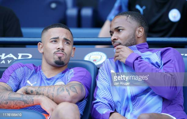 Raheem Sterling and Gabriel Jesus of Manchester City in discussion on the bench prior to the Premier League match between Manchester City and Watford...