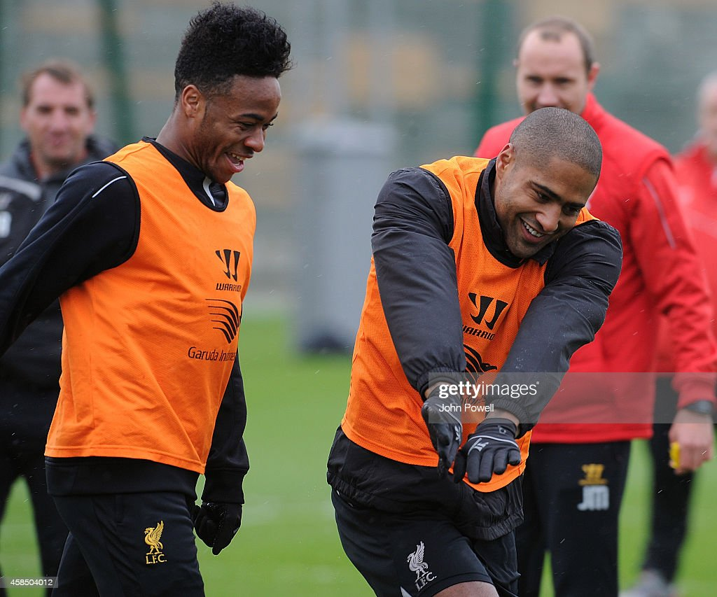 Raheem Sterling and Glen Johnson of Liverpool in action during a training session at Melwood Training Ground on November 6, 2014 in Liverpool, England.