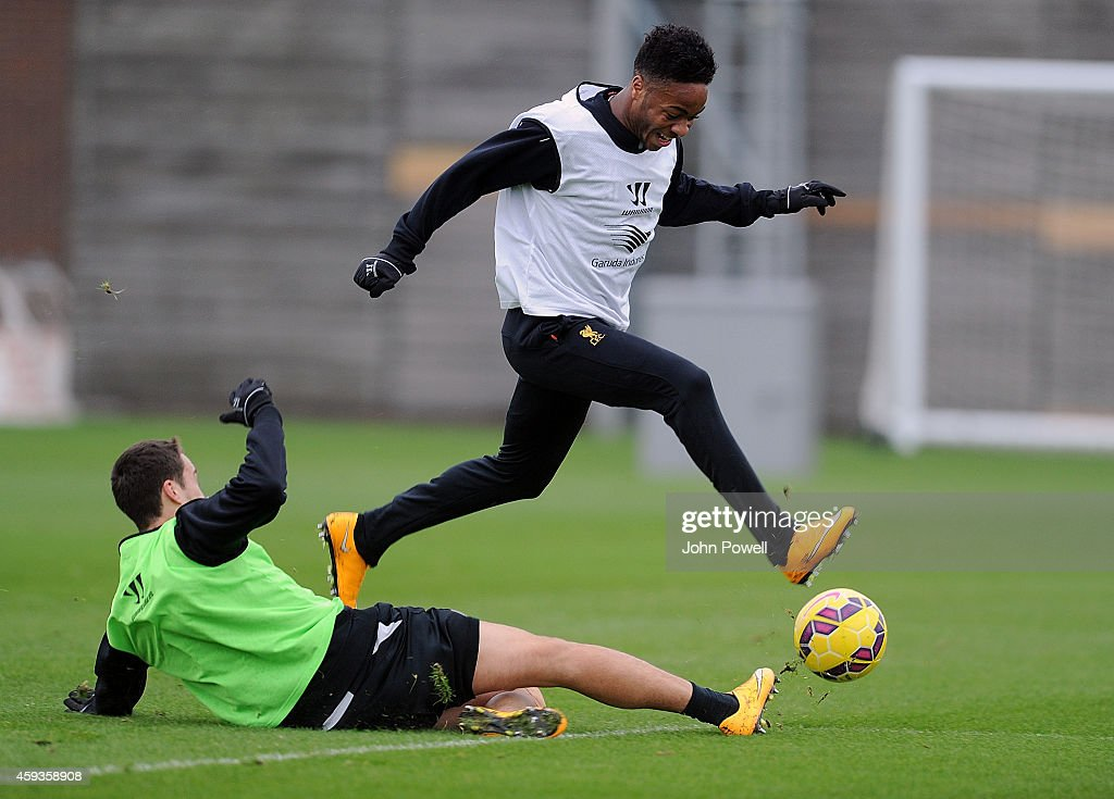 Raheem Sterling and Javier Manquilo of Liverpool during a training session at Melwood Training Ground on November 21, 2014 in Liverpool, England.