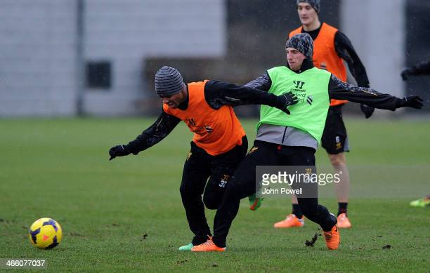 Raheem Sterling and Joe Allen of Liverpool in action during a training session at Melwood Training Ground on January 31 2014 in Liverpool England