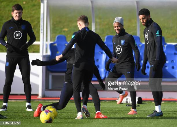 Raheem Sterling and Joe Gomez attend a training session during and England Media Access Day at St Georges Park on November 13 2019 in BurtonuponTrent...