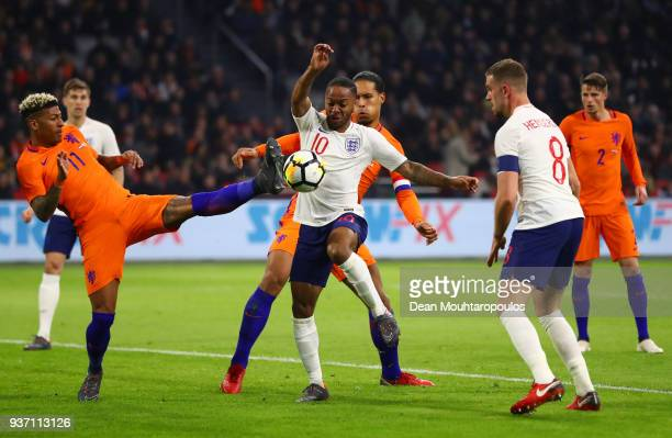 Raheem Sterling and Jordan Henderson of England battle with Patrick van Aanholt and Virgil van Dijk of the Netherlands during the international...