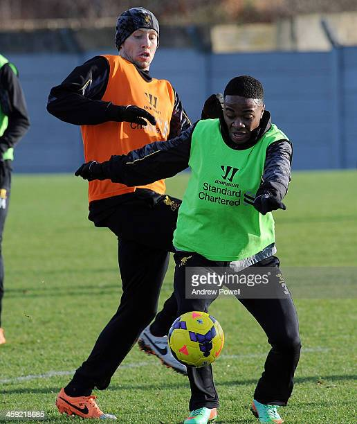 Raheem Sterling and Philippe Coutinho of Liverpool in action during a training session at Melwood Training Ground on December 24 2013 in Liverpool...