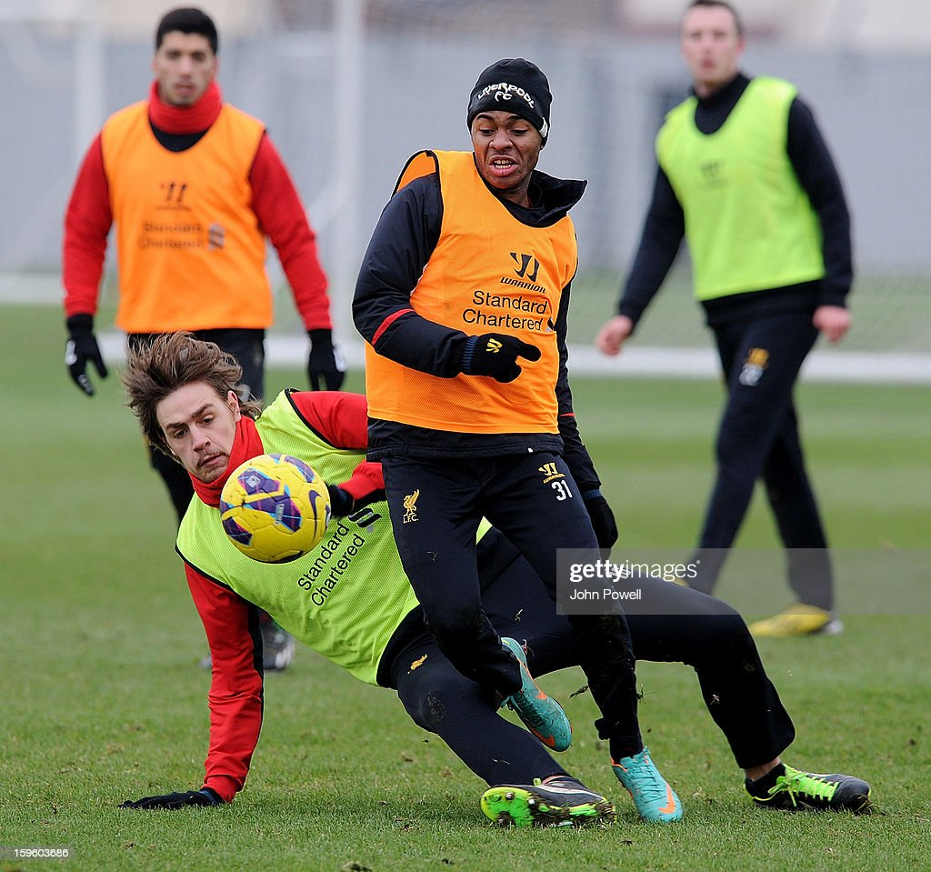 Raheem Sterling and Sebastian Coates of Liverpool in action during a training session at Melwood Training Ground on January 17, 2013 in Liverpool, England.
