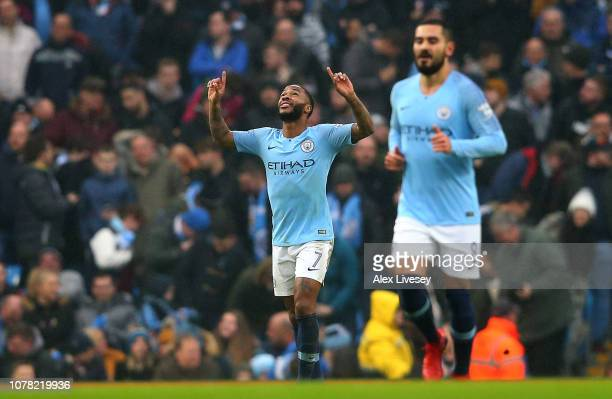 Raheem Sterling celebrates after scoring his team's first goal during the FA Cup Third Round match between Manchester City and Rotherham United at...