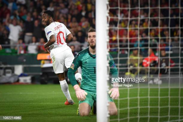 Raheem Sterling celebrates his second goal as David de Gea looks on during the UEFA Nations League A group four match between Spain and England at...