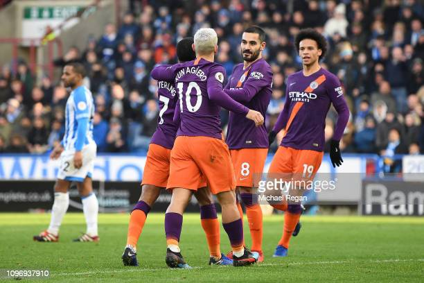 Raheem Sterling celebrates with team mates aftscoring his sides second goal during the Premier League match between Huddersfield Town and Manchester...