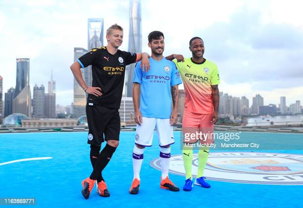 Raheem Sterling David Silva and Oleksandr Zinchenko of Manchester City take part in a photoshoot on a Puma / Manchester City branded Heli Pad on the...