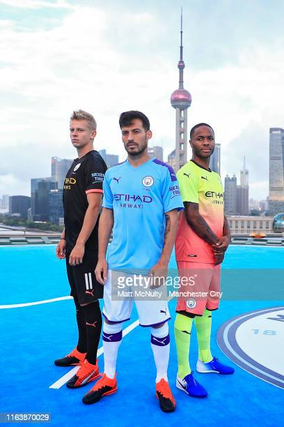 Raheem Sterling, David Silva and Oleksandr Zinchenko of Manchester City take part in a photoshoot on a Puma / Manchester City branded Heli Pad on the...