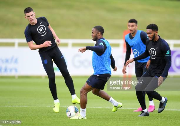 Raheem Sterling Declan Rice Joe Gomez and Jesse Lingard train during an England Media Access day at St Georges Park on September 02 2019 in...