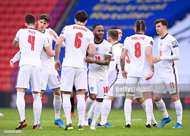 Raheem Sterling, Harry Maguire of England and teammates embrace prior to the FIFA World Cup 2022 Qatar qualifying match between Albania and England...