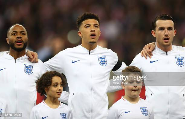 Raheem Sterling Jadon Sancho and Ben Chilwell of England line up for the national anthem prior to the 2020 UEFA European Championships Group A...