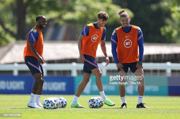 Raheem Sterling, John Stones and Kalvin Phillips of England laugh during the England training session on June 05, 2021 in Middlesbrough, England.