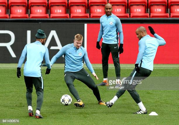 Raheem Sterling Kevin de Bruyne and Vincent Kompany of Manchester City in action during the teams training session prior to the UEFA Champions League...